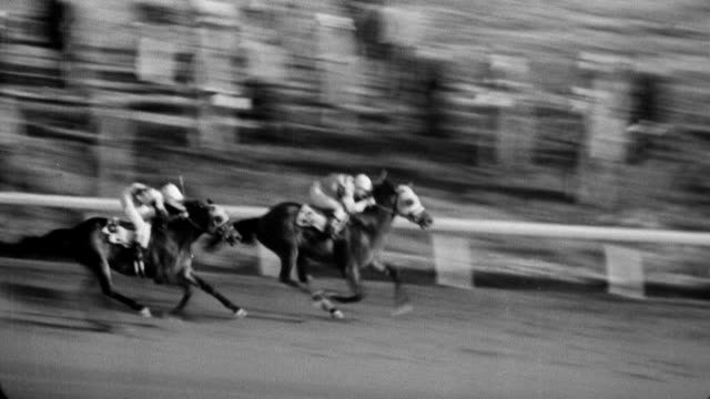 vidéos et rushes de agua caliente handicap horse race begins and horses are out of the gate / horses running around the track / winner gallant sir walks around / jockey... - 1933