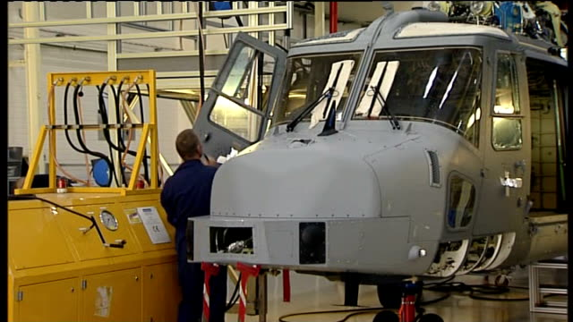 somerset yeovil agustawestland int worker working on helicopter rotors at factory helicopter under construction bv worker on factory floor - helicopter rotors stock videos and b-roll footage