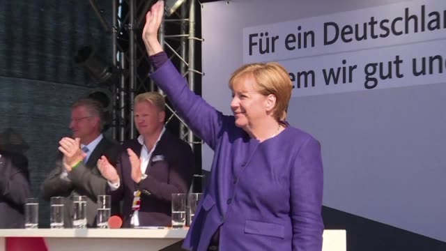 Ahead of next week's election German Chancellor Angela Merkel addresses her supporters in the German city of Binz and says we live in tormented times...