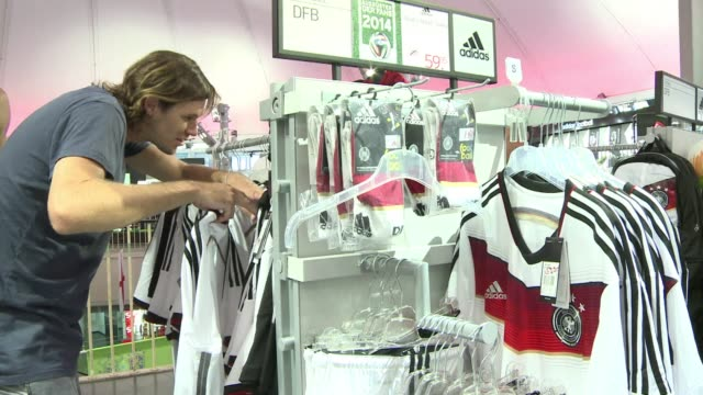 ahead of sundays world cup final in brazil supporters of the german national team in berlin are making last minute football shirt purchases - national team stock videos & royalty-free footage