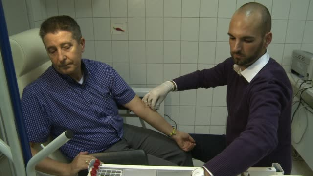 ahead of world aids day on sunday hungarys tasz association has organised a week of hiv screening tests in a country which has the lowest screening... - retrovirus stock videos and b-roll footage