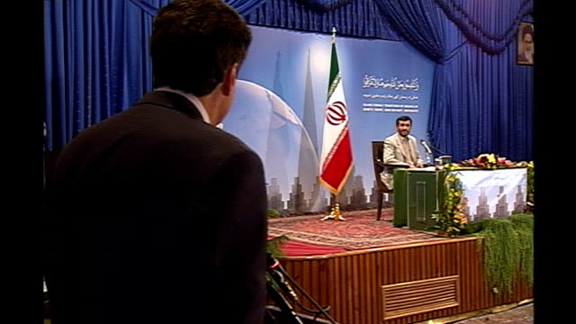 ahmadinejad announces release of the fifteen british captured sailors press packed into seats and standing at back julian manyon asking a question... - press release stock videos and b-roll footage