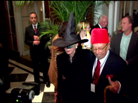 ahmet artegun and guest at the nyrp celebration of 10th anniversary and bette midler's 60th birthday with 'hulaween' gala at the waldorf astoria in... - waldorf astoria new york stock videos & royalty-free footage