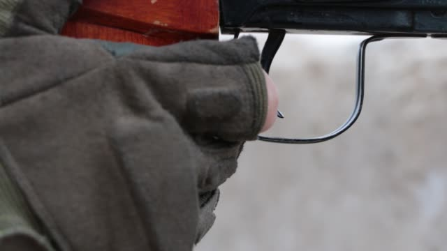 ahrar alsham sniper cu view of the trigger and wooden grip of a svd dragunov sniper rifle the sniper is a member of harakat ahrar alsham - trigger stock videos & royalty-free footage