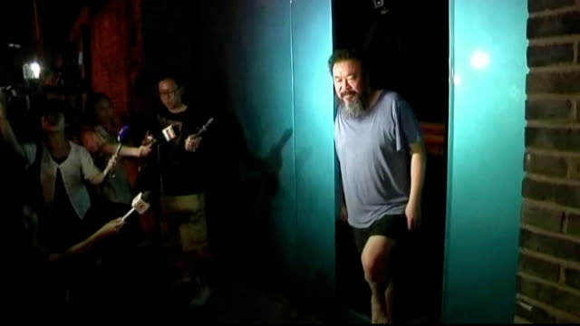 Ai Weiwei barred from court hearing LIB PHOTOGRAPHY*** Ai Weiwei standing in his doorway talking to press and being photographed