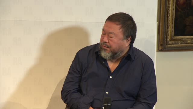 vídeos de stock e filmes b-roll de ai weiwei press conference at royal academy; england: london: royal academy of the arts: int ai weiwei along to seat and intro sot / ai weiwei press... - royal academy of arts
