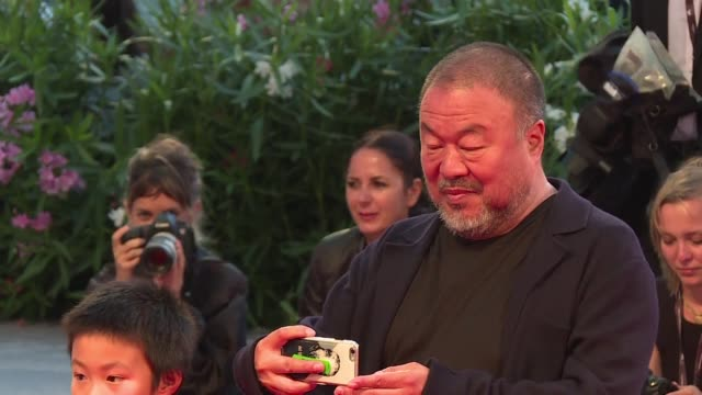 Ai Weiwei walks the red carpet Friday in Venice where he is presenting his film Human Flow an epic 23 country documentary essay on the global refugee...