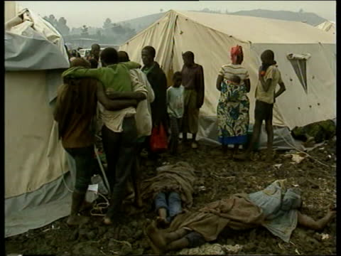 aid airlifts begin / refugee health concerns nat goma tgv massive refugee camp almost obscured by steam and smoke pan rl ms wrapped body stretchered... - polyethylene stock videos and b-roll footage