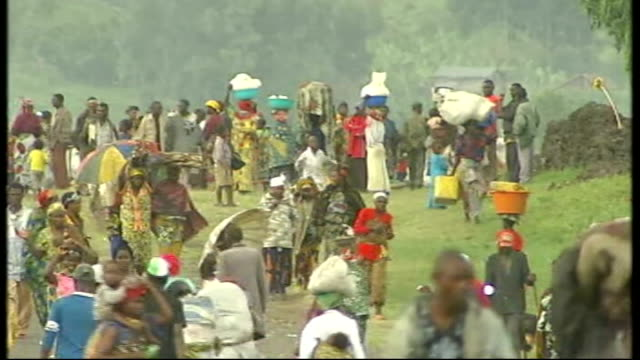 aid groups struggle to reach refugees democratic republic of congo goma ext general views of displaced people along road near refugee camp - コンゴ民主共和国点の映像素材/bロール