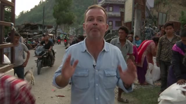 stockvideo's en b-roll-footage met aid starts to arrive in remote areas following earthquake; legs of women walking along track **bahadur interview partly overlaid sot** villagers... - start en landingsbaan