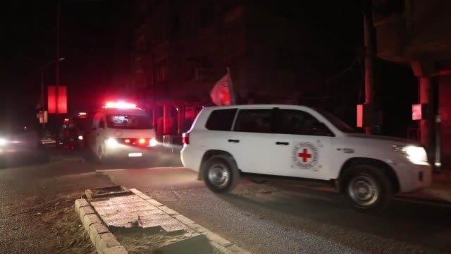 aid workers have begun evacuating emergency medical cases from syria's besieged rebel bastion of eastern ghouta the red cross said on wednesday after... - red cross stock videos & royalty-free footage
