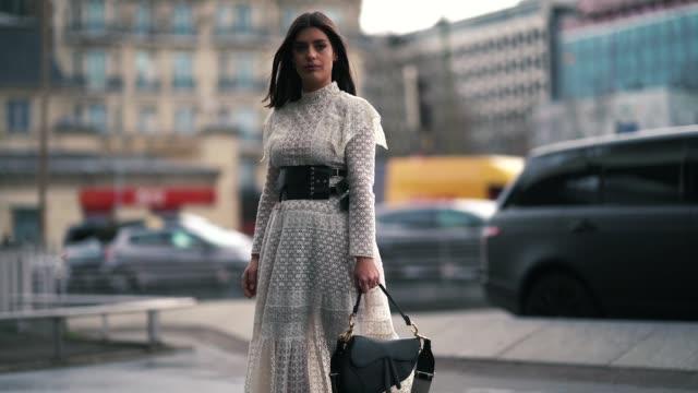 Aida Domenech wears a seethrough white lace dress a black Dior belt a Dior bag outside Giambattista Valli during Paris Fashion Week Womenswear...