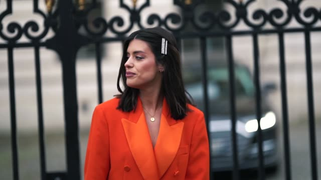 stockvideo's en b-roll-footage met aida domenech wears an orange blazer jacket, flared pants, snake print shoes, outside altuzarra, during paris fashion week womenswear fall/winter... - blazer