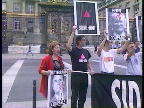 Aids infected blood trials FRANCE Paris GV Palais de Justice PAN LR to group of demonstrators with placards MS Demonstrators hold up placards LMS...
