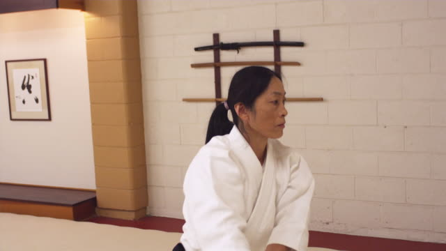 ms ts aikido athlete practicing with wooden sword / portland, oregon, usa - 剣点の映像素材/bロール