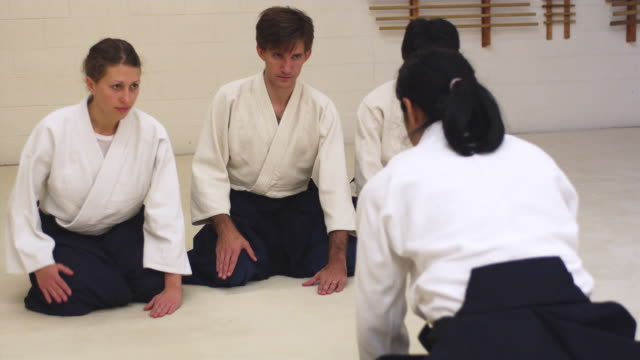 MS Aikido instructor and students bowing in dojo / Portland, Oregon, USA