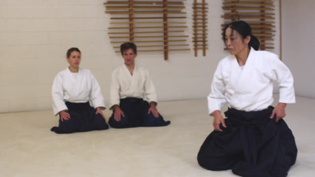 MS TS Aikido instructor teaching students in dojo / Portland, Oregon, USA