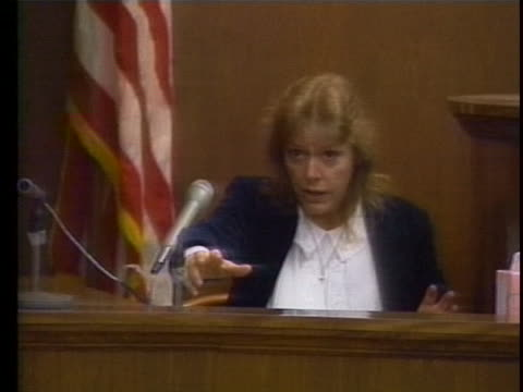 aileen wuornos testifies during her murder trial for first degree pre-meditated murder, first degree felony murder and armed robbery. - crime or recreational drug or prison or legal trial点の映像素材/bロール