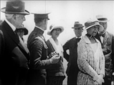 b/w 1923 ailing warren g harding standing with military man florence harding / newsreel - 1923 stock videos & royalty-free footage