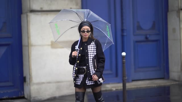 aimee song wears a black and white tweed jacket, black thigh high leather boots, sunglasses, a bandanna over the hair,, outside balmain, during paris... - thigh human leg stock videos & royalty-free footage