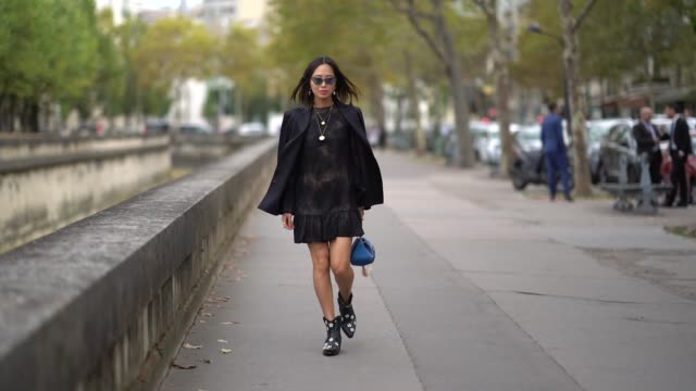 aimee song wears a black blazer jacket a black lace dress a blue bag outside valentino during paris fashion week womenswear spring/summer 2019 on... - street style stock videos & royalty-free footage