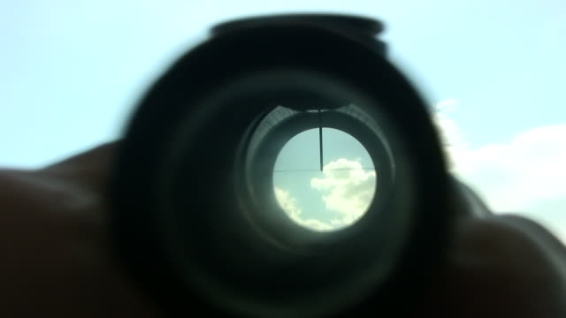 aiming the target aspirations - looking through an object stock videos & royalty-free footage