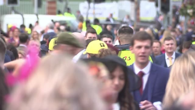 local newspaper calls for end of 'unflattering' photographs ENGLAND Merseyside Aintree Racecourse EXT Various shots of women racegoers arriving at...
