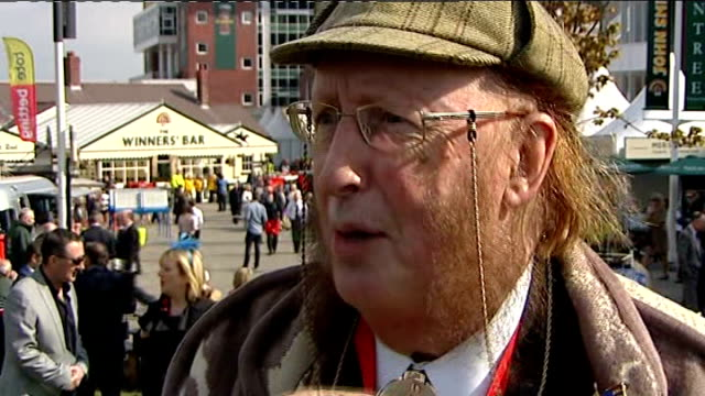 stockvideo's en b-roll-footage met aintree meeting ladies' day fashions england merseyside liverpool aintree racecourse ext group of women spectators in dresses and hats john mccririck... - john mccririck