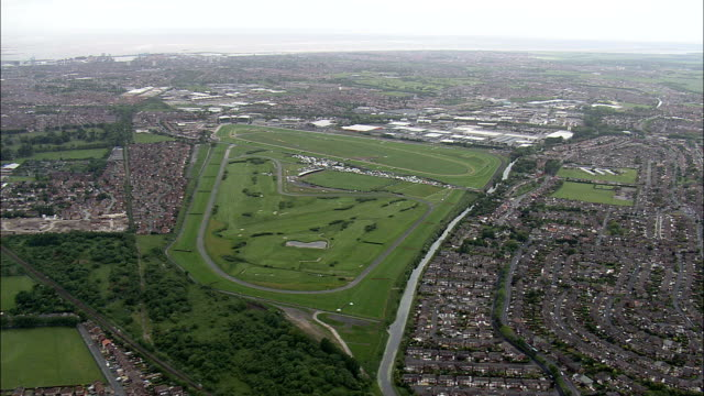 aintree racecourse  - aerial view - england,  sefton,  aintree village helicopter filming,  aerial video,  cineflex,  establishing shot,  united kingdom - horse racing stock videos and b-roll footage
