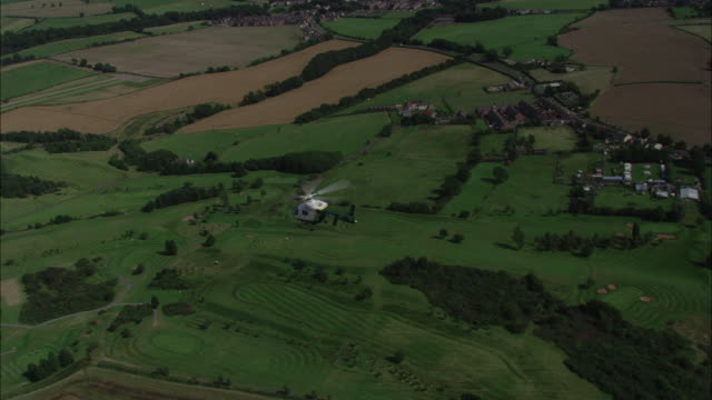 air ambulance flying over fields northumberland available in hd. - 2000s style stock videos & royalty-free footage