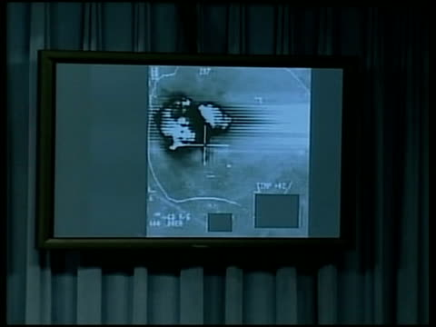 air attacks continue/bush visits china pool washington int cockpit video of bomb explosions shown on screen at press briefing - reuters stock videos & royalty-free footage