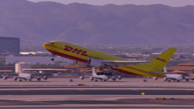 dhl air caro flight from phoenix - cargo aeroplane stock videos & royalty-free footage