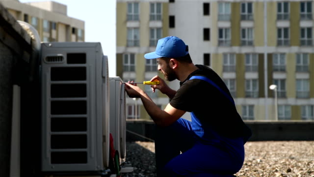 air conditioner installing - 4k resolution - repairman stock videos & royalty-free footage