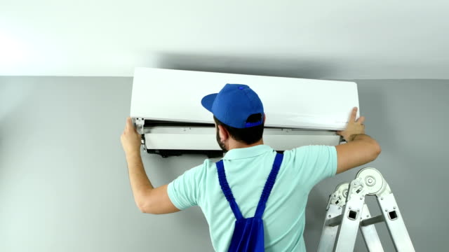 air conditioner installing - 4k resolution - installing stock videos & royalty-free footage