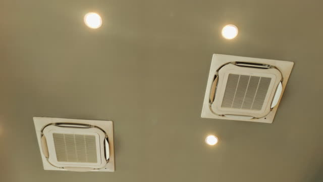 air conditioner on ceiling - air duct stock videos & royalty-free footage