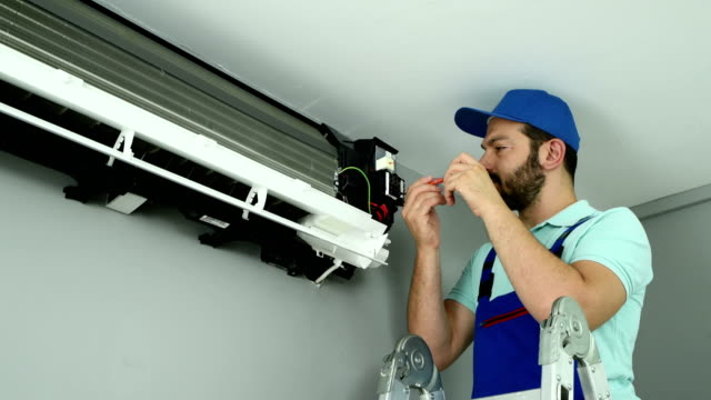 air conditioner service - 4k resolution - installing stock videos & royalty-free footage