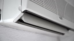 Air conditioner with open horizontal jalousies in room