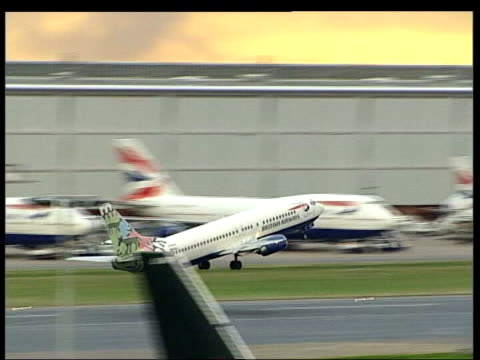 Air fares rise because of increase in oil price ITN GENERICS HELD SERVER London Heathrow Airport EXT British Airways aircraft taxiing and taking off...