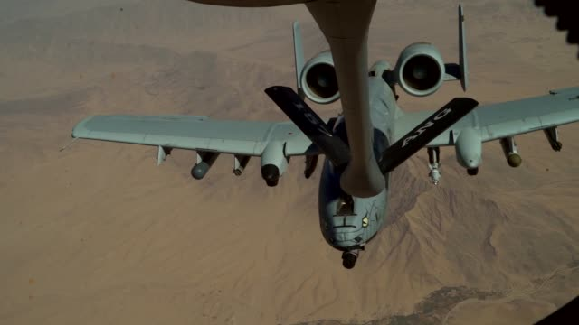 air force a-10 thunderbolt ii receives fuel from a kc-135 stratotanker assigned to the 340th expeditionary air refueling squadron during a refueling... - us military stock videos & royalty-free footage