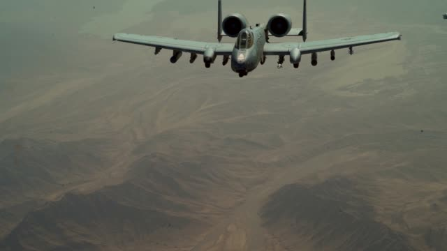 a us air force a10 thunderbolt ii receives fuel from a kc135 stratotanker assigned to the 340th expeditionary air refueling squadron during a... - us airforce stock videos & royalty-free footage
