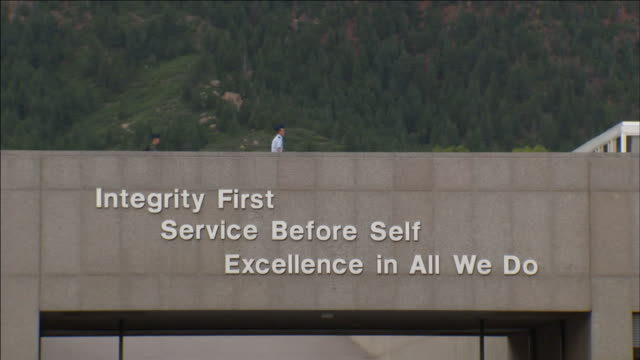 air force academy cadets walk over an overpass that displays the academy's motto. - cadet stock videos & royalty-free footage