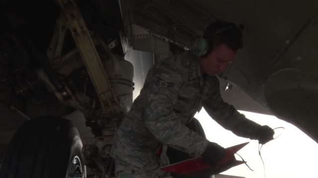 US Air Force airmen perform a cart start with a B52 Stratofortress during a simulated nuclear exercise at Bossier City Air force Base Louisiana