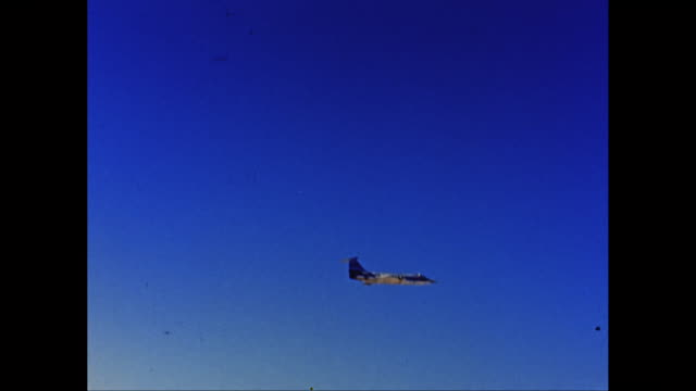 WS TS US Air Force airplane flying against blue sky / United States