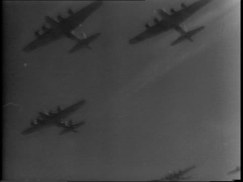 air force b-17 bombers flying / bomber with damage lands on runway / damaged plane on ground being inspected / bombers fly in formation / aerial... - air force stock videos & royalty-free footage