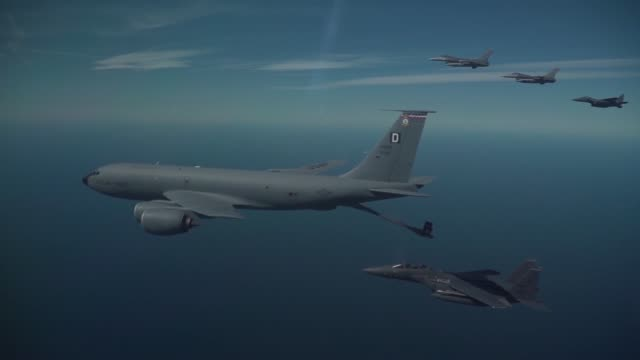 a us air force b1b lancer a us air force kc135 stratotanker two us air force f15e strike eagles and two us air force f16c fighting falcons refuel and... - general dynamics f 16 falcon stock videos & royalty-free footage