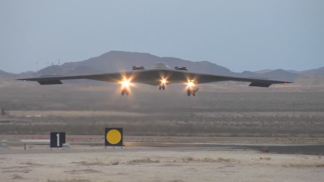 a us air force b2 spirit assigned to the 13th bomb squadron at whiteman afb mo lands during red flag 141 feb 6 at nellis afb nev the b2 is a... - stealth stock videos and b-roll footage