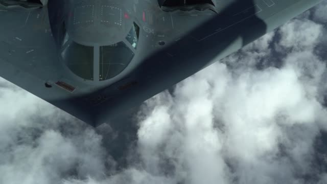 us air force b2 spirit is flanked by two british royal air force f35 lightning ii's during a bomber task force training exercise above the uk prior... - tail stock videos & royalty-free footage