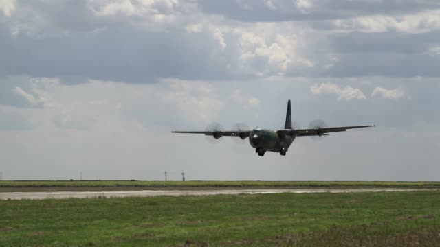 a us air force c130 hercules and romanian air force c130 hercules deliver romanian paratroopers at boboc air base romania during exercise carpathian... - military airplane stock videos & royalty-free footage