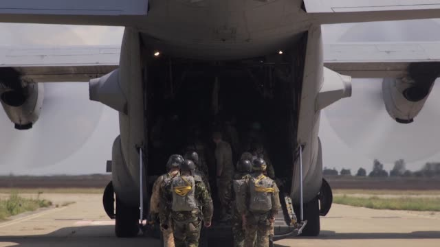 a us air force c130 hercules and romanian air force c130 hercules deliver romanian paratroopers at boboc air base romania during exercise carpathian... - free falling stock videos & royalty-free footage