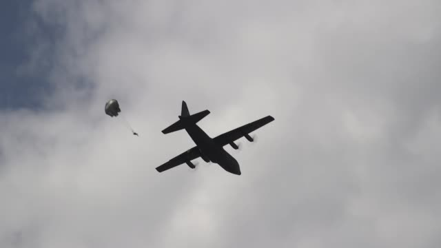 a us air force c130 hercules and romanian air force c130 hercules deliver romanian paratroopers at boboc air base romania during exercise carpathian... - parachute stock videos & royalty-free footage